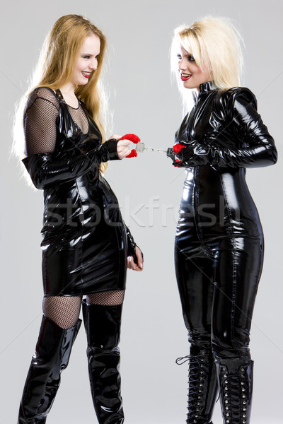 women in latex with handcuffs Stock photo © phbcz
