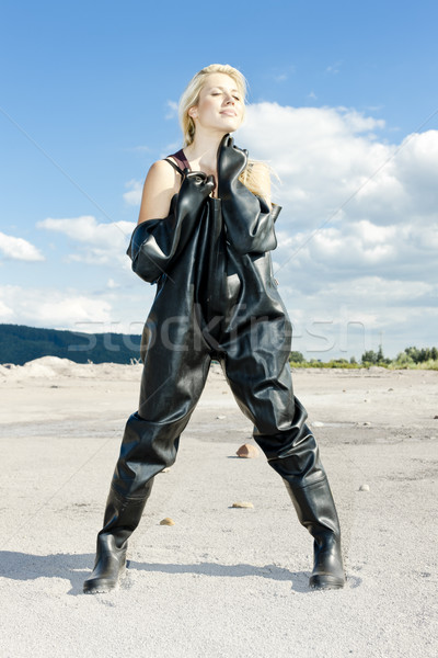 standing woman wearing protective clothes Stock photo © phbcz