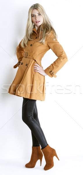 standing woman wearing coat and fashionable brown shoes Stock photo © phbcz