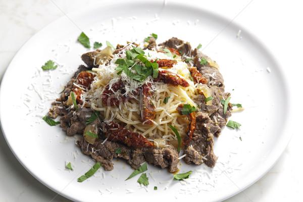 Spaghetti carne carne essiccati pomodori piatto Foto d'archivio © phbcz