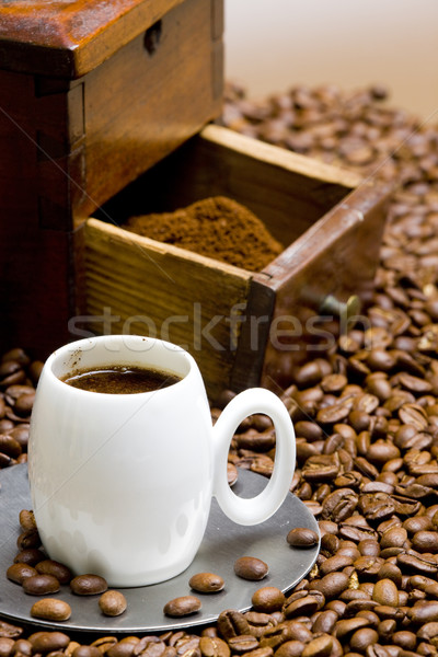 detail of coffee mill with coffee beans and cup of coffee Stock photo © phbcz