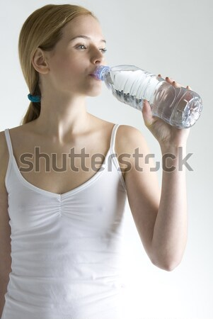 woman with towel on head drinking water Stock photo © phbcz