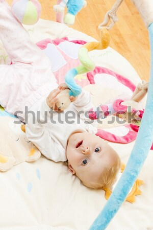 baby girl with toys sitting on the carpet Stock photo © phbcz