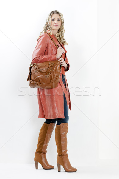 Femme mode brun bottes sac à main Photo stock © phbcz