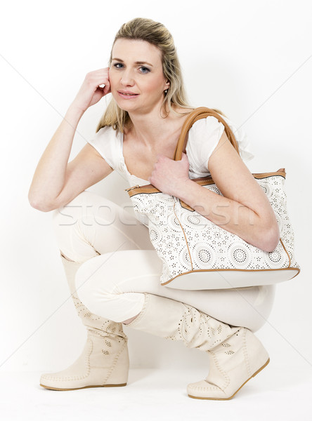 woman wearing summer boots with a handbag Stock photo © phbcz