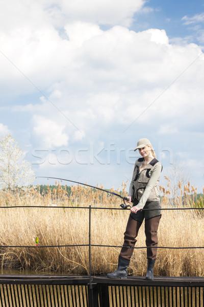 Kobieta połowów molo staw wiosną kobiet Zdjęcia stock © phbcz