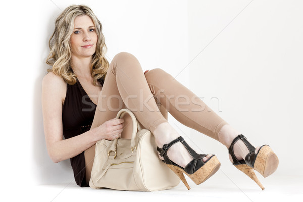 sitting woman wearing summer clothes and shoes with a handbag Stock photo © phbcz