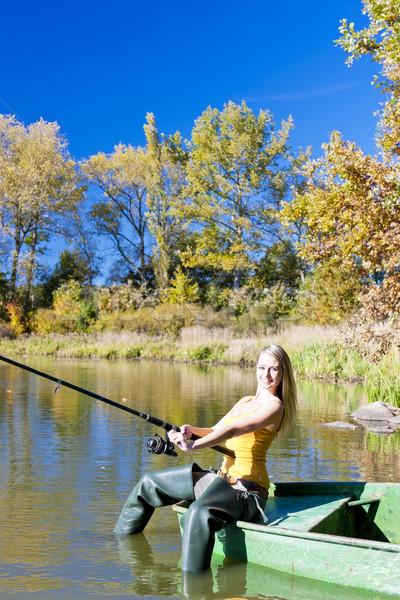 fishing woman sitting on boat Stock photo © phbcz