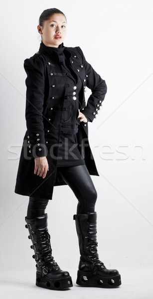 standing woman wearing extravagant clothes and boots Stock photo © phbcz