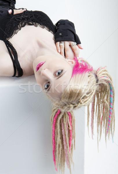 portrait of lying young woman with dreadlocks Stock photo © phbcz