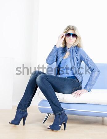 Frau tragen blau Kleidung Handtasche Sitzung Stock foto © phbcz