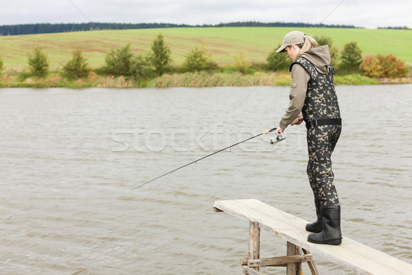 woman fishing on pier at pond Stock photo © phbcz