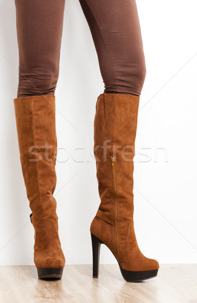 detail of standing woman wearing brown boots Stock photo © phbcz
