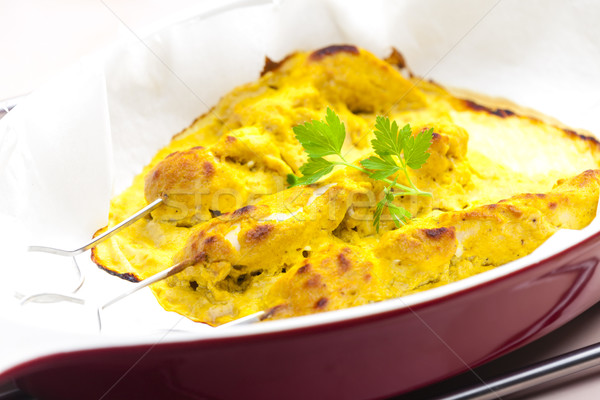 baked Indian curry chicken skewers in marinade Stock photo © phbcz