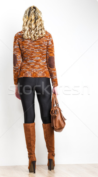 standing woman wearing fashionable brown boots with a handbag Stock photo © phbcz