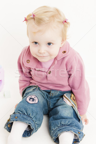 portait of sitting little girl wearing jeans Stock photo © phbcz