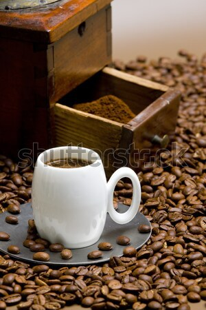 coffee mill with coffee beans and cup of coffee Stock photo © phbcz