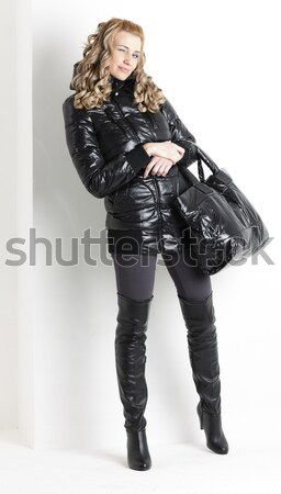 standing woman wearing fashionable black boots Stock photo © phbcz