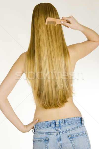 combing woman wearing jeans Stock photo © phbcz