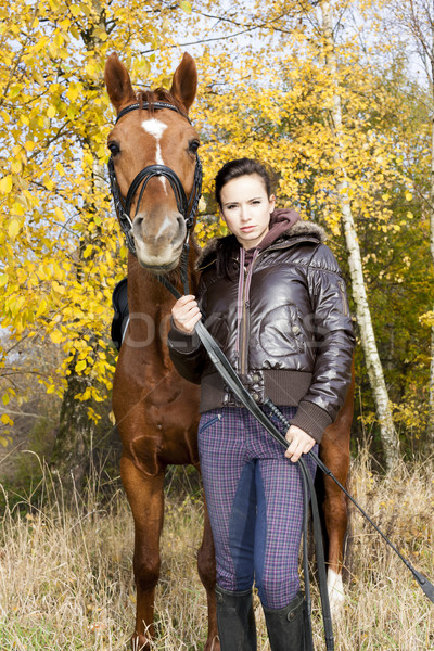 equestrian with her horse in autumn Stock photo © phbcz