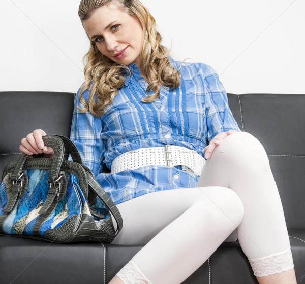 Frau Handtasche Sitzung Sofa weiß Person Stock foto © phbcz