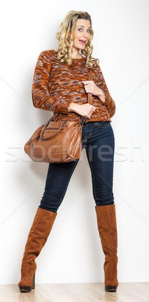 áll nő visel farmer kézitáska személy Stock fotó © phbcz