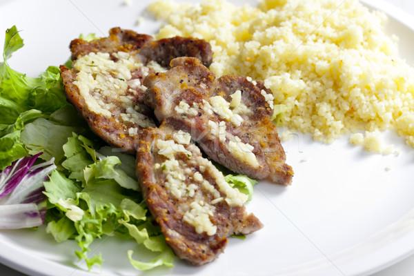 Grelhado carne de porco pescoço alho couscous prato Foto stock © phbcz