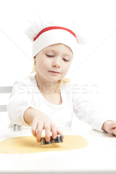 little girl cutting cookies Stock photo © phbcz