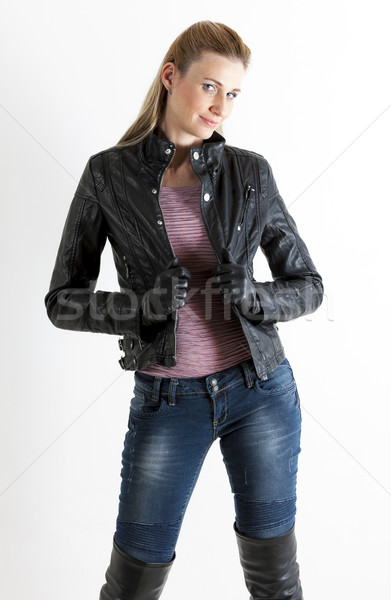 portrait of standing woman wearing jeans and black boots Stock photo © phbcz