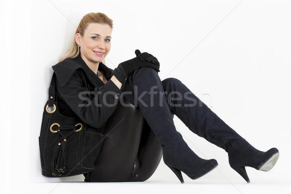 ül nő visel fekete ruházat csizma Stock fotó © phbcz