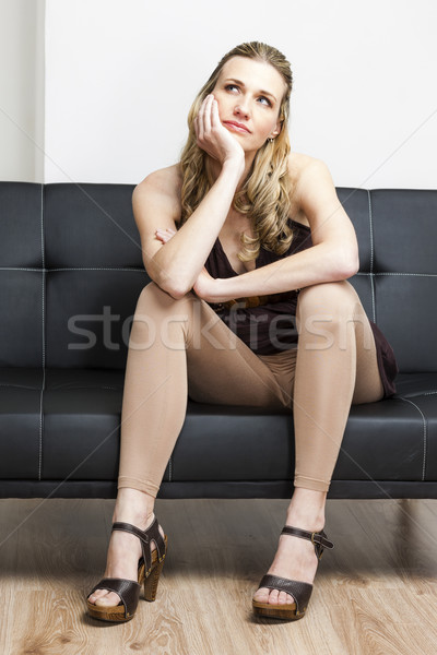 woman wearing summer shoes sitting on sofa Stock photo © phbcz