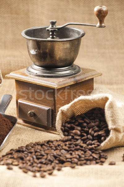 still life of coffee beans in jute bag with coffee grinder Stock photo © phbcz