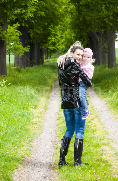 mother with her little daughter in spring alley Stock photo © phbcz