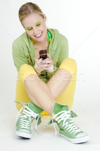 sitting woman with a mobile phone Stock photo © phbcz
