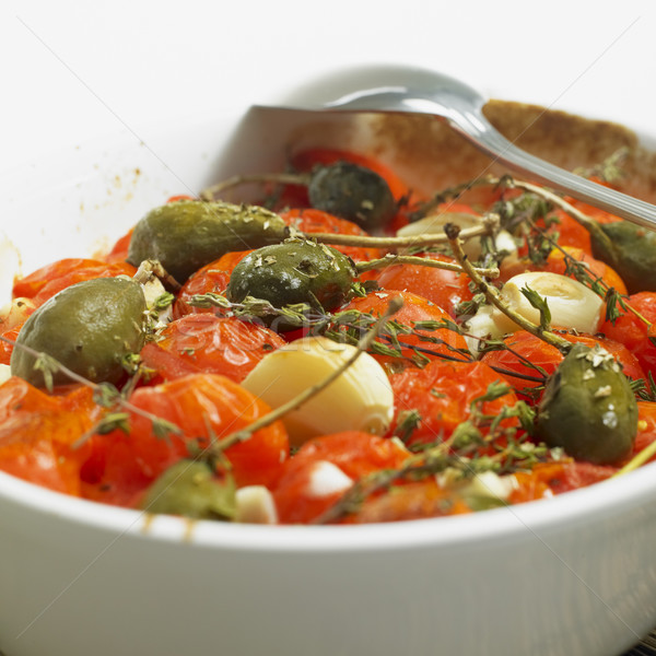 warm tomato salad with capers Stock photo © phbcz