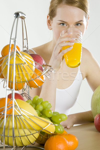 Mujer desayuno frutas salud naranja gafas Foto stock © phbcz