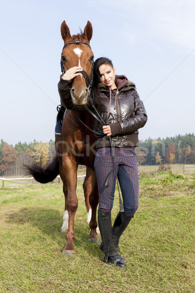equestrian with her horse on meadow Stock photo © phbcz
