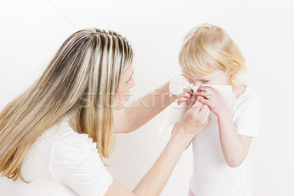potrait of mother looking after her daughter Stock photo © phbcz