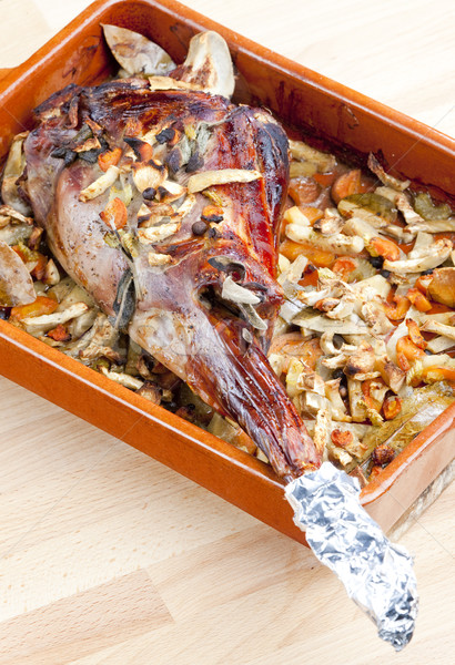 venison rump baked on vegetables with bay leaf and Jamaica peppe Stock photo © phbcz