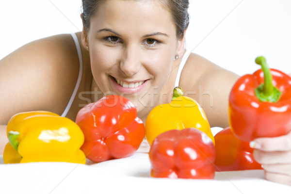 portrait of woman with peppers Stock photo © phbcz