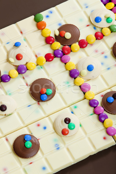still life of white chocolate with smarties Stock photo © phbcz