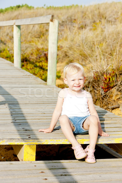 little girl sitting on footbridge Stock photo © phbcz
