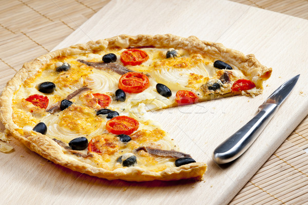 cake with anchovies, cherry tomatoes and black olives Stock photo © phbcz