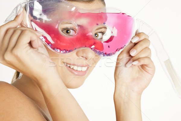portrait of young woman with cooling facial mask Stock photo © phbcz