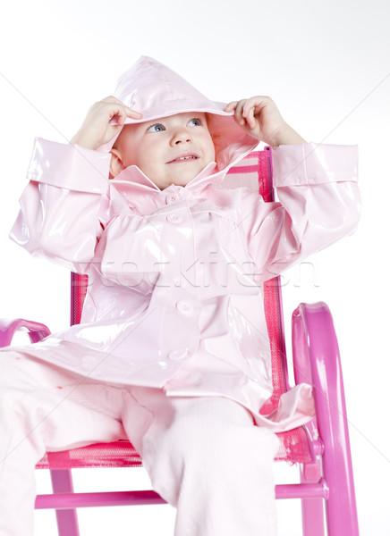 Portré kislány visel esőkabát ül szék Stock fotó © phbcz