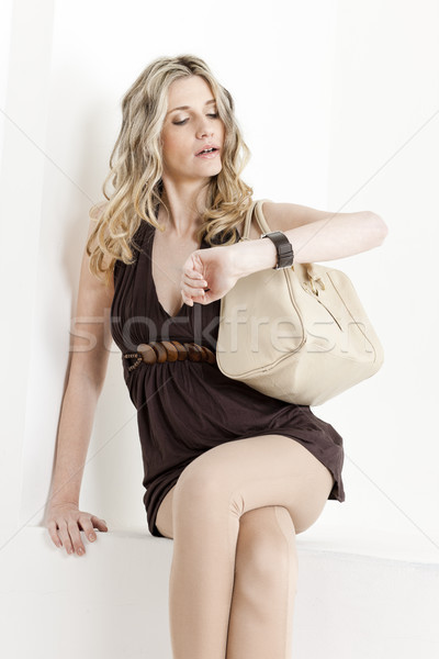portrait of woman looking at wristwatch Stock photo © phbcz
