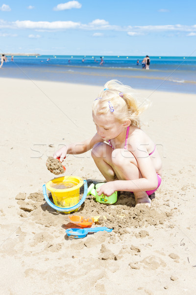 little girl playing on the beach at sea Stock photo © phbcz