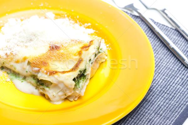 Lasaña salmón espinacas interior tenedor comida Foto stock © phbcz