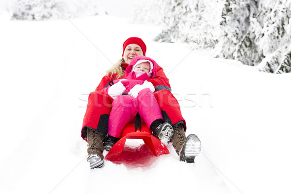 sledding mother and her little daughter Stock photo © phbcz