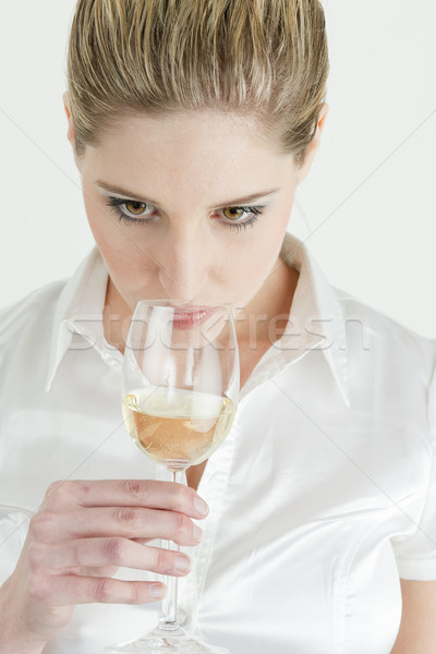 portrait of young woman tasting white wine Stock photo © phbcz